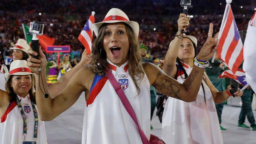 Team Puerto Rico arrives during the opening ceremony for the 2016 Summer Olympics in Rio de Janeiro, Brazil, Friday, Aug. 5, 2016. (AP Photo/David J. Phillip)