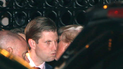 President-elect Donald Trump, right, kisses his son Eric farewell after dining at the 21 Club, Tuesday, Nov. 15, 2016, in New York.