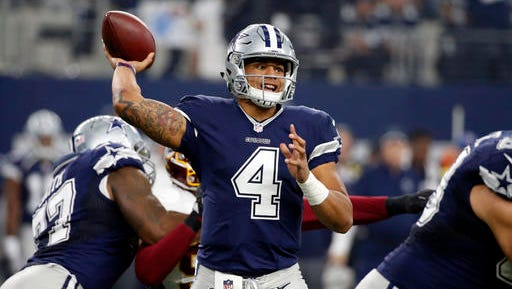 Dallas Cowboys quarterback Dak Prescott (4) throws a pass during the first half of an NFL football game against the Washington Redskins on Thursday, Nov. 24, 2016, in Arlington, Texas.