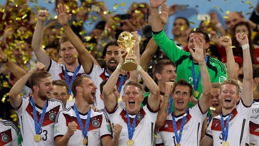 FILE - In this July 13, 2014 file photo Germany's Bastian Schweinsteiger holds up the World Cup trophy as the team celebrates their 1-0 victor over Argentina after the World Cup final soccer match between Germany and Argentina at the Maracana Stadium in Rio de Janeiro, Brazil. FIFA is about to make the World Cup a bigger and, it hopes, richer event even at the cost of lower quality soccer. FIFA President Gianni Infantino hopes his ruling Council will agree Tuesday, Jan. 10, 2017 to expand the 2026 World Cup to 48 nations, playing in 16 groups of three teams.
