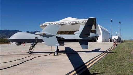 A U.S. Customs and Border Patrol drone aircraft is prepped prior to it's flight, Wednesday, Sept 24, 2014 at Ft. Huachuca in Sierra Vista, Ariz. The U.S. government now patrols nearly half the Mexican border by drones alone in a largely unheralded shift to control desolate stretches where there are no agents, camera towers, ground sensors or fences, and it plans to expand the strategy to the Canadian border. It represents a significant departure from a decades-old approach that emphasizes boots on the ground and fences. (AP Photo/Matt York)