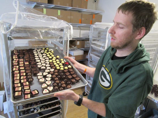 Dan Donoghue, co-owner of Chocolate Caper, shows off