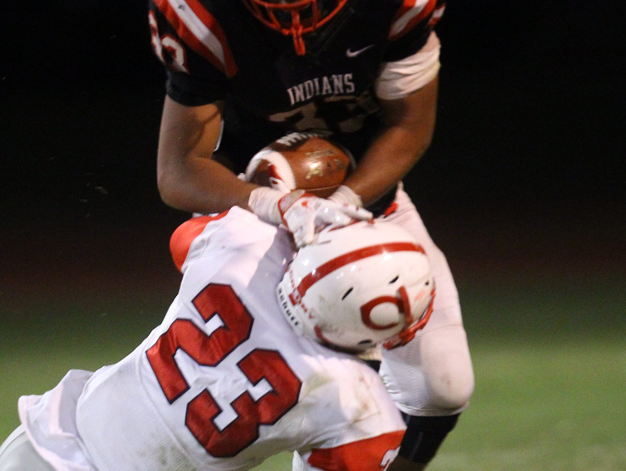 Palm Springs High School's Joshua Barlow gets tackled during a run against Colony during their CIF post-season game against Colony on November 11, 2016.