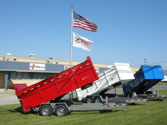 Three trailers on display in front of BWise Manufacturing