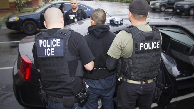 In this photo released by U.S. Immigration and Customs Enforcement, foreign nationals are arrested Feb. 7, 2017, during a targeted enforcement operation conducted by U.S. Immigration and Customs Enforcement (ICE) aimed at immigration fugitives, re-entrants and at-large criminal aliens in Los Angeles.