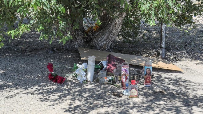 A small memorial sits at the base of the tree where Malcolm Harsch's body was found in Victorville, Ca., June 16, 2020.