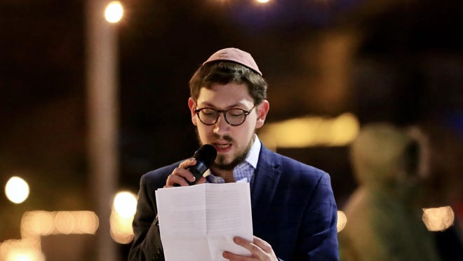 Rabbi Berel Slavaticki of the Seacoast Chabad Jewish Center speaks to the crowd gathered for the first public menorah lighting in Portsmouth at Strawbery Banke in 2019.