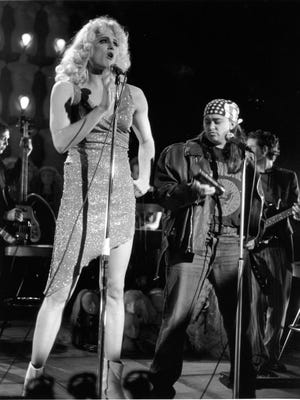 """Todd Almond, left,  starred in ETC's 2003 production of """"Hedwig and the Angry Inch."""" Seen here with him is Beth Harris, in the role of Yitzhak. A new production of the show will close ETC's 2017-2018 season."""