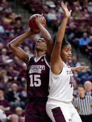 Mississippi State center Teaira McCowan (15) shoots behind Texas A&M center Ciera Johnson (40) during the first half of an NCAA college basketball game Sunday, Feb. 17, 2019, in College Station, Texas. (AP Photo/Michael Wyke)