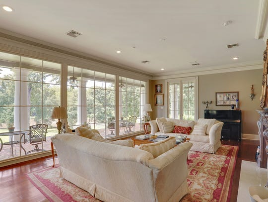 The formal living room offers a view of the Vermilion