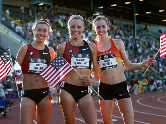 Left to right, Emily Infeld, Shalane Flanagan and Molly Huddle pose together after the women's 10,000 meter run Thursday.