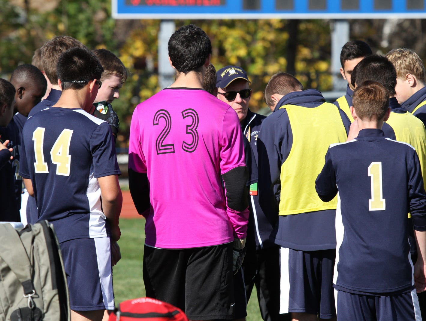 Notre Dame head coach Brian Adams talks to his team during halftime of Sunday's 9-1 win over Solomon Schechter in the New York state Class C championship game in Middletown.