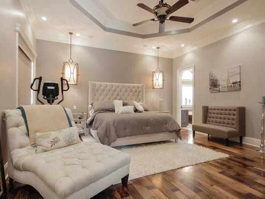 Soothing colors make the master bedroom warm and inviting.