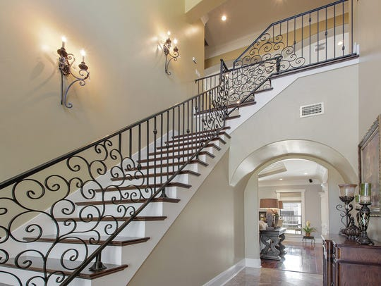 A grogeous staircase leads to the spacious upstairs.