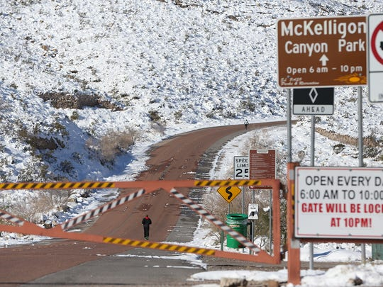Runners take advantage of a closed roadway to run at McKelligon Canyon Monday. The road remained closed to vehicular traffic due to treacherous conditions.