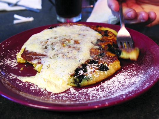 Blueberry pancakes slathered in butter from Crave in Fort Myers.