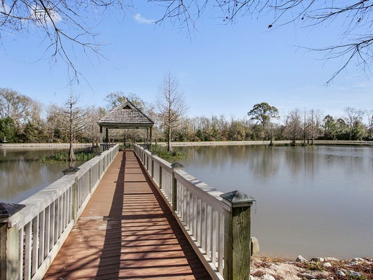 There is a fully stocked pond and gazebo on the property.
