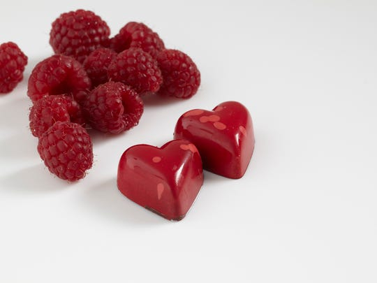 Inside the heart-shaped shell of dark chocolate in these Kohler candies is a soft, raspberry ganache.