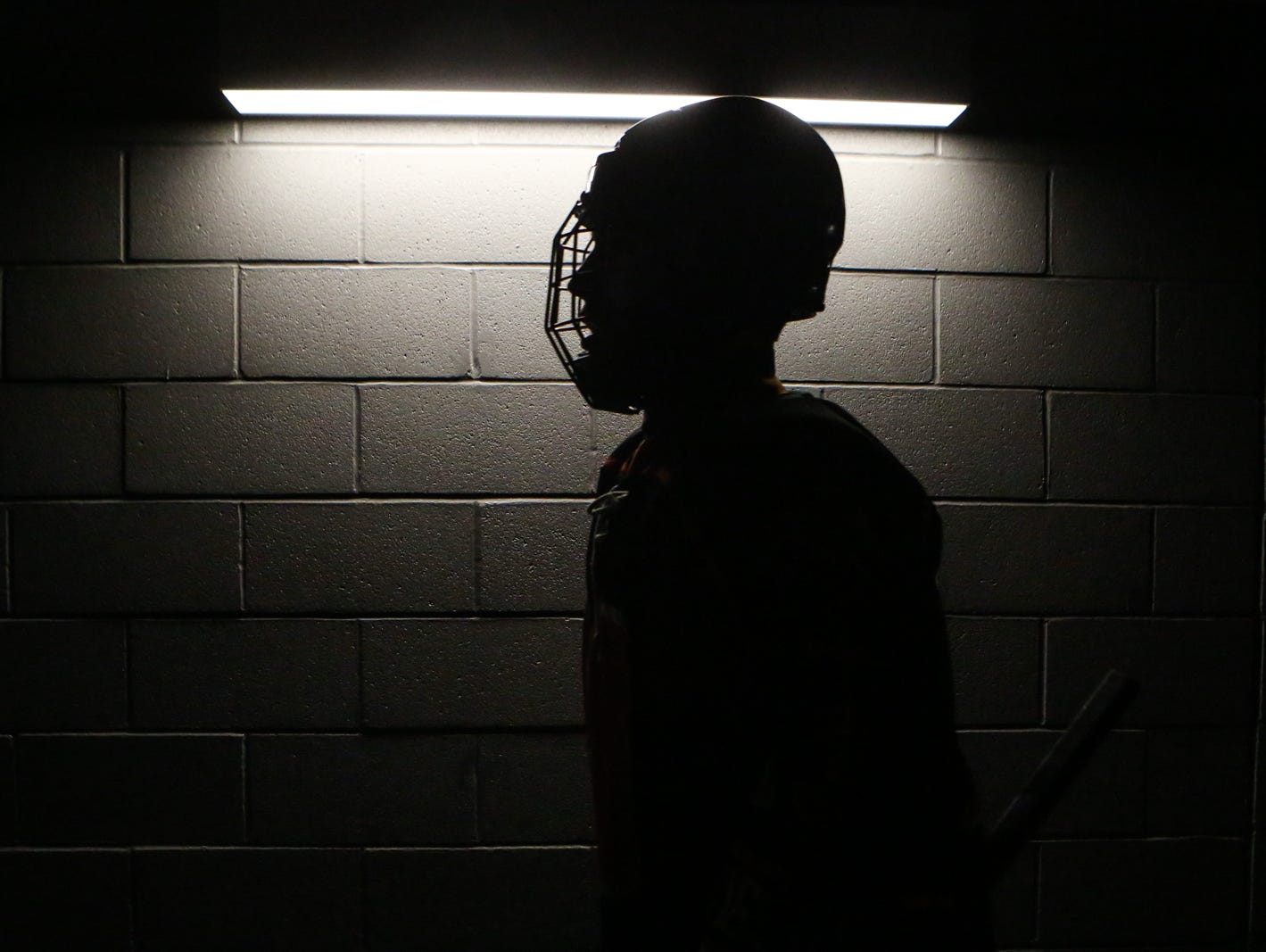 A silhouette photograph of Mamaroneck player heading to the ice rink. Mamaroneck defeated West Genesee 1-0 and won the NYSPHSAA Division 1 HarborCenter in Buffalo, NY.