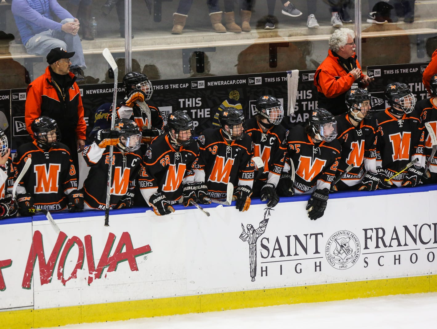 Mamaroneck players watch the game on the bleachers in the first period. Mamaroneck defeated West Genesee 1-0 and won the NYSPHSAA Division 1 HarborCenter in Buffalo, NY.