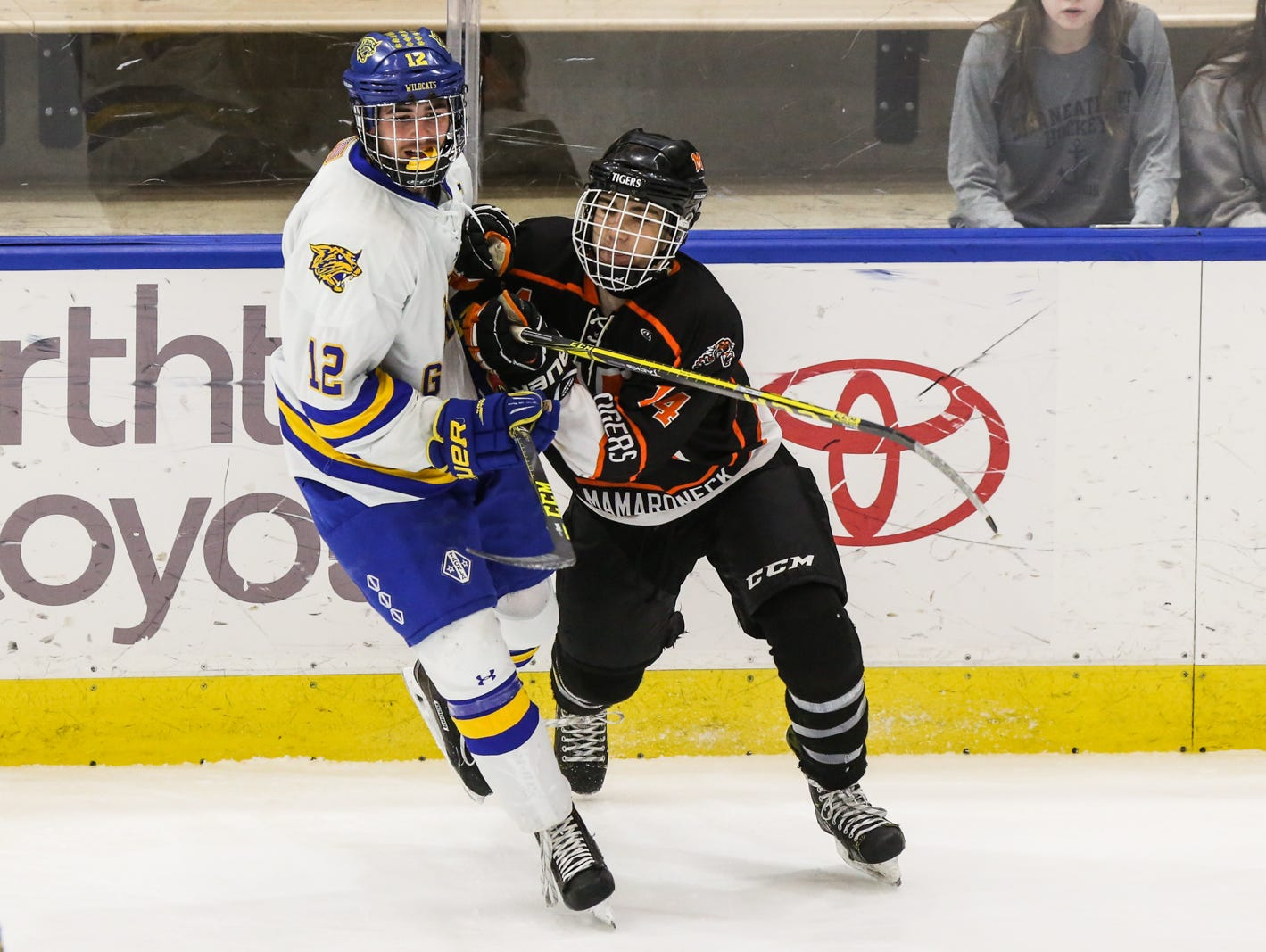 Mamaroneck's Tucker Leicht (14) checks West Genesee's Matthew McDonald (12) in the first period. Mamaroneck defeated West Genesee 1-0 and won the NYSPHSAA Division 1 HarborCenter in Buffalo, NY.