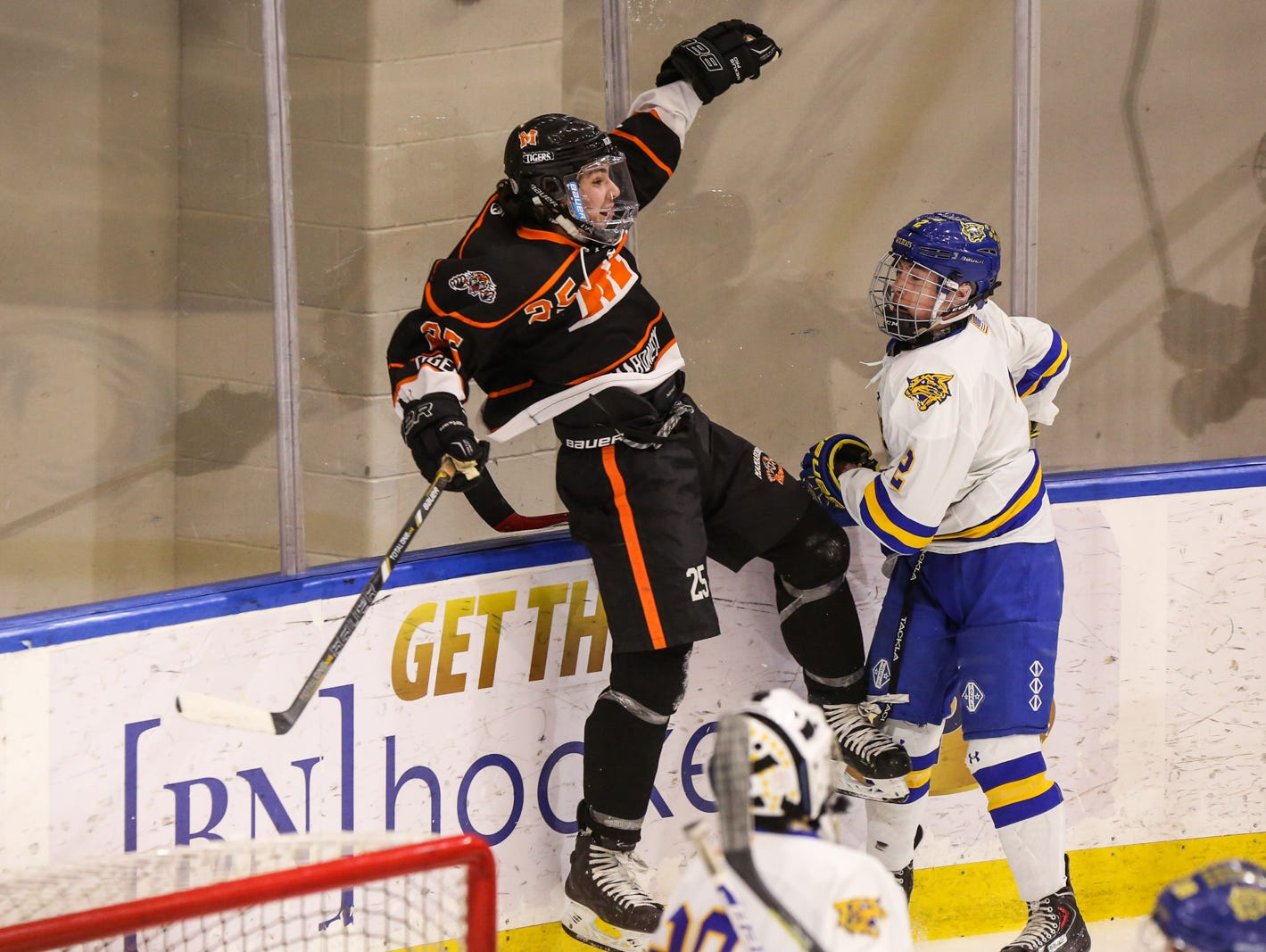 Mamaroneck's Michael Carducci (25) celebrates his goal as West Genesee's Conor Bartlett (2) reacts in the first period. Mamaroneck defeated West Genesee 1-0 and won the NYSPHSAA Division 1 HarborCenter in Buffalo, NY.