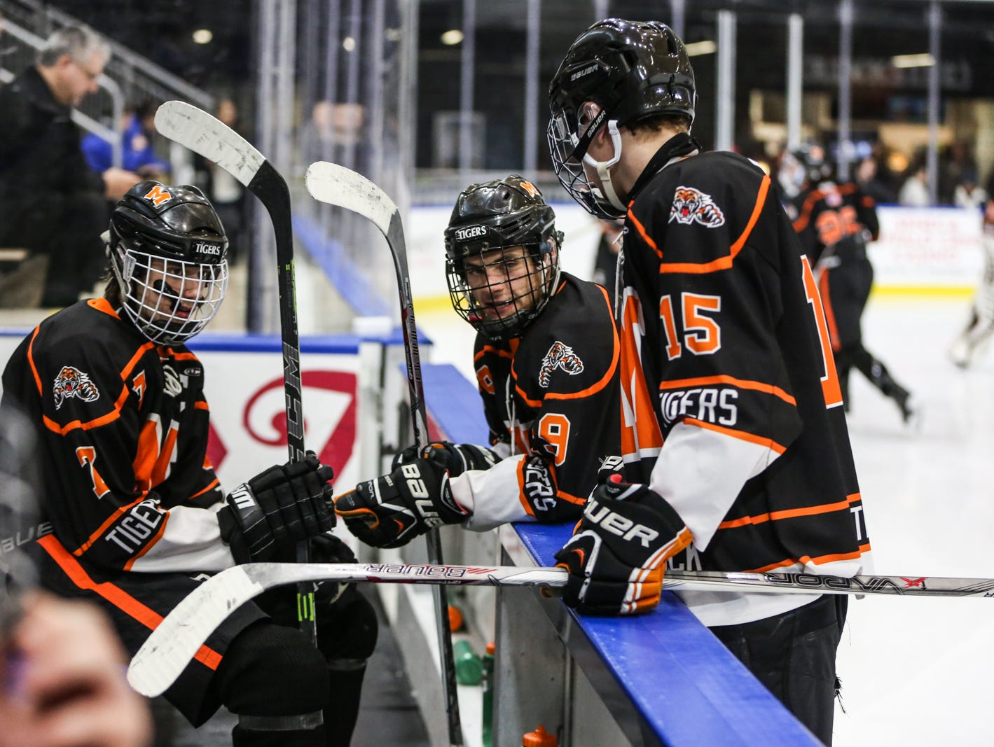 Mamaroneck's Alex Ewald (7) Connor Leblanc (8), and James Torre (15) talk before the third period starts. Mamaroneck defeated West Genesee 1-0 and won the NYSPHSAA Division 1 HarborCenter in Buffalo, NY. Nick Serrata - For The Journal News