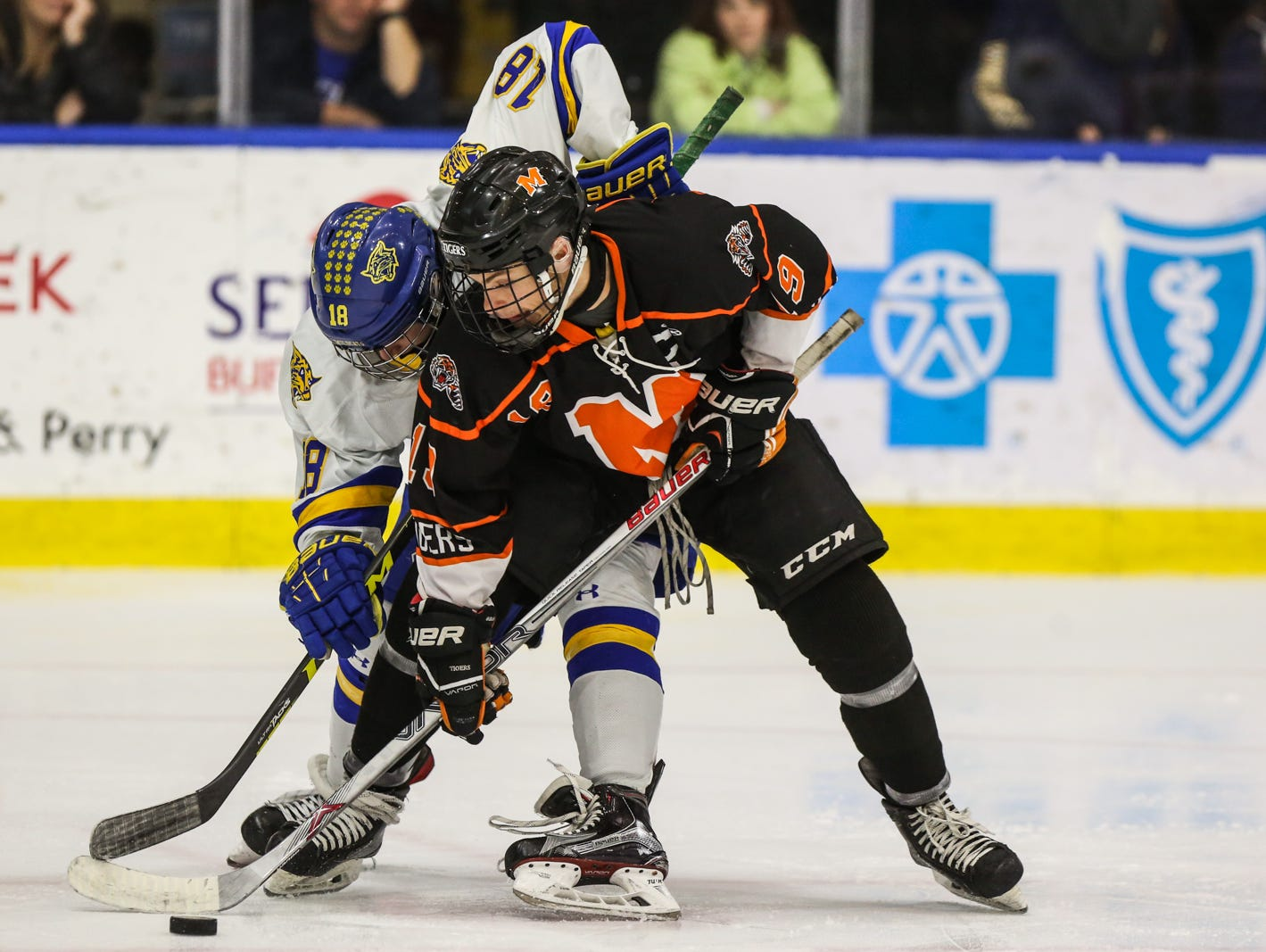 Mamaroneck's Will Kirk (19) and West Genesee's Patrick McDonald (18) ties up at the face-off in the second period. Mamaroneck defeated West Genesee 1-0 and won the NYSPHSAA Division 1 HarborCenter in Buffalo, NY. Nick Serrata - For The Journal News