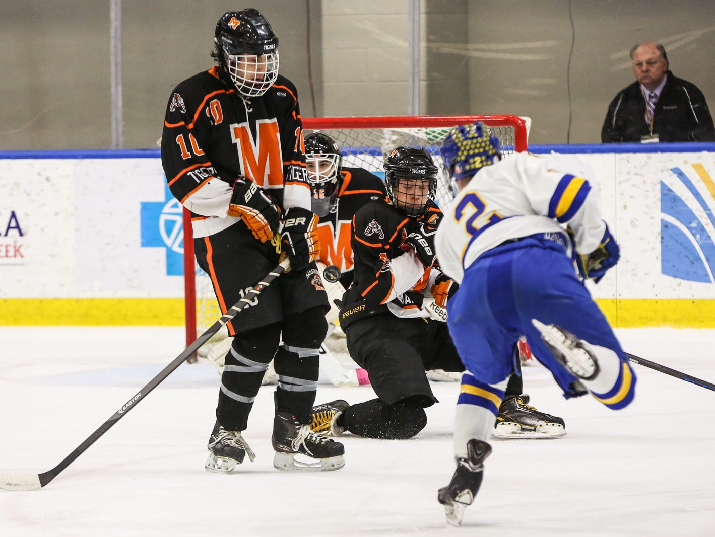 Mamaroneck's Ben Kahan (10) and Nick Campbell (4) tried to block West Genesee's Conor Bartlett shot as goalie Tommy Spero (35) keeps an eye on the puck in the second period. Mamaroneck defeated West Genesee 1-0 and won the NYSPHSAA Division 1 HarborCenter in Buffalo, NY.