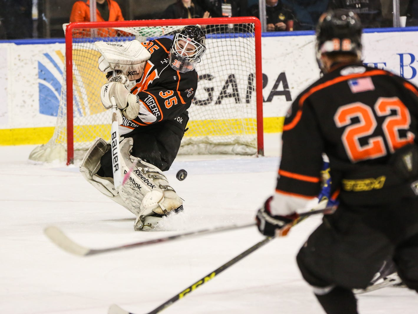 Mamaroneck's Tommy Spero (35) clears the puck in the third period. Mamaroneck defeated West Genesee 1-0 and won the NYSPHSAA Division 1 HarborCenter in Buffalo, NY.
