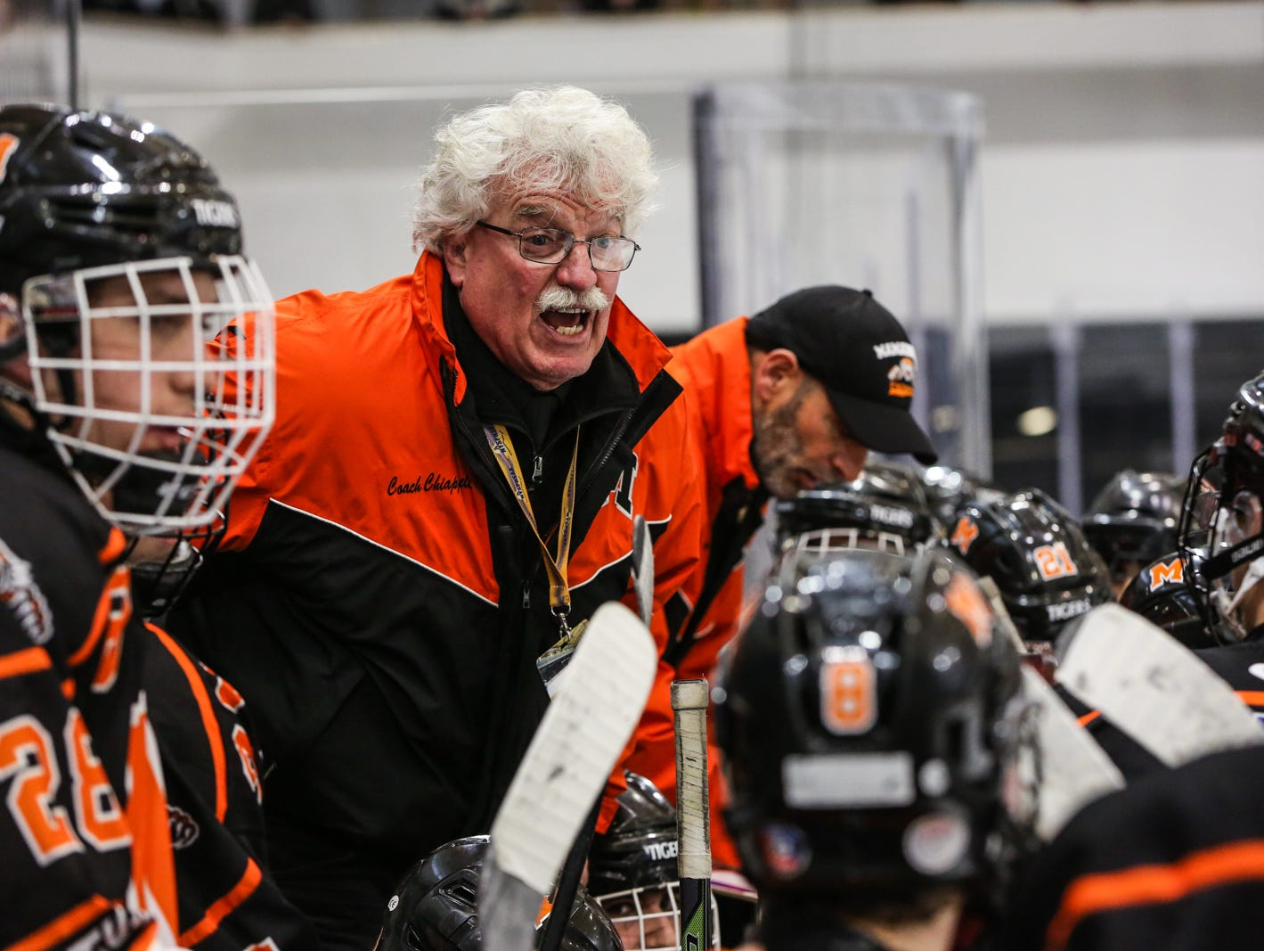 Mamaroneck's Head Coach Michael Chiapparelli (center) talks to his players in the third period. Mamaroneck defeated West Genesee 1-0 and won the NYSPHSAA Division 1 HarborCenter in Buffalo, NY.