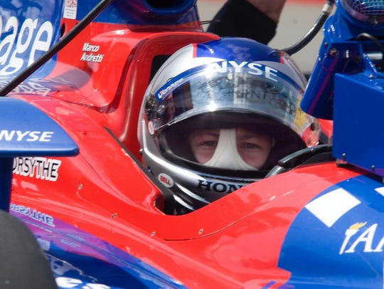 Marco Andretti waits on pit row in his IndyCar at Watkins