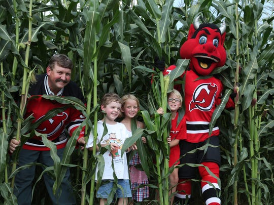 """Kurt Alstede and kids at Alstede Farms in Chester Township, getting ready for a """"Devils Corn Maze Face Off.'' in 2009."""