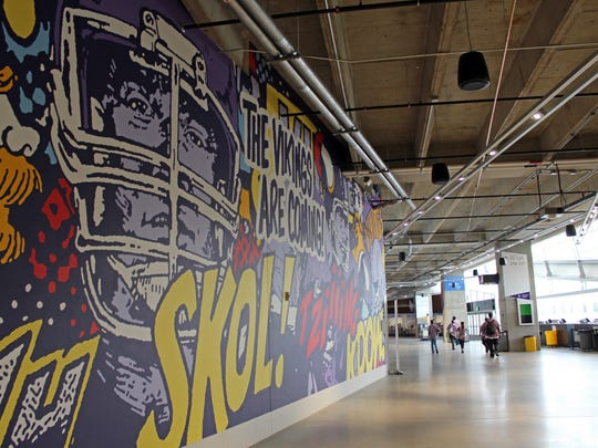 """""""The Vikings Are Coming!"""" is a floor-to-ceiling mural that artist Greg Gossel was commissioned to design and hand-paint in the stadium."""