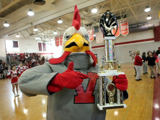 The school mascot poses with the Daily Journal Homecoming