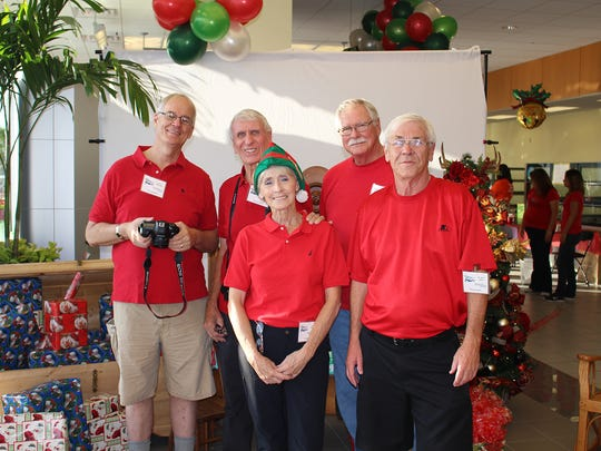 Treasure Coast Photography Center members Spencer Rutledge, Jeff Kraengel, Connie Kraengel, John Furlong and Jerry Swain take pictures at New Horizons Breakfast with Santa.