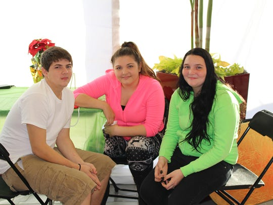 Volunteers from Fort Pierce Central High School Tyler Garwood, Destiny Franz and Heather Lorec, all ninth graders