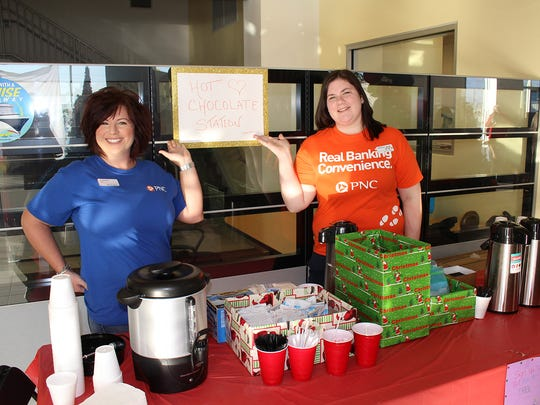 Tiffany Nixon and Ashley Oliva from PNC at the hot chocolate station