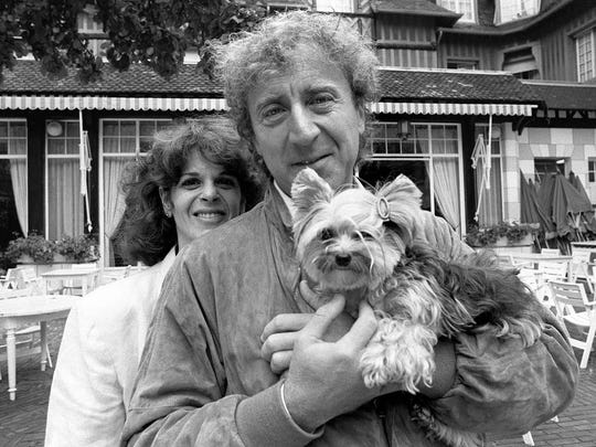 This file photo taken on September 7, 1984 shows actor and director Gene Wilder posing with his wife Gilda Radner, during the 10th American Film Festival of Deauville.
