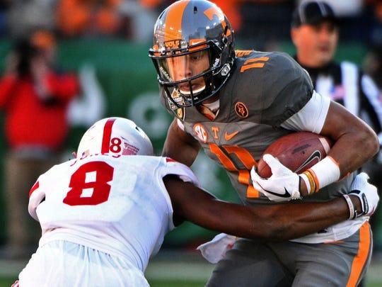 Tennessee quarterback Joshua Dobbs is tackled by Nebraska