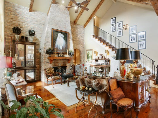 The living area boasts soaring cathedral ceilings and