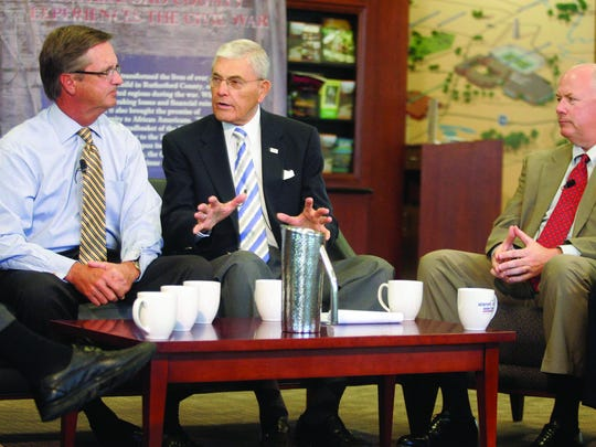 """""""Murfreesboro Storytellers"""" host John Hood, center, interviews former Murfreesboro Mayor Tommy Bragg, left, and current Rutherford County Chamber of Commerce Director Paul Lature."""