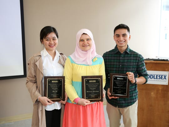 Three Middlesex County College students were recently honored for essays they created on the topic of Thinking About Education. In the contest, organized by the MCC History and Philosophy Honor Society, the students read the story of a Native American child who went to Carlisle Indian School in Pennsylvania from 1883 to 1890. They then answered two questions in their essays: What is the purpose of education, and did the main character receive a good education? Their essays were published in the society's journal, Free Thought/ Pensamiento Libre, issue 2, 2017, and each received a plaque. The winners, from left: From left, Han Le of Somerset, Katsiaryna Sikorskaya of East Brunswick and Fernando Faura of Avenel. The History and Philosophy Honor Society, created in 2015, empowers and fosters students' interest on history and philosophy and aims to strengthen members' ability to transfer to history and philosophy programs around the nation, and ultimately to graduate school.