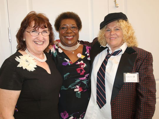 St. Lucie School Board member Kathryn Hensley and artists Doretha Hair and Anita Prentice