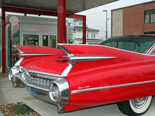 At the entrance of The Automobile Gallery, Green Bay, is a 1959 Cadillac Coupe de Ville.