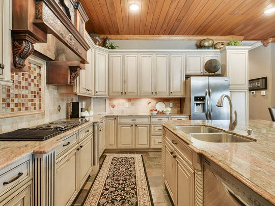 There is plenty of cabinet space in this gourmet kitchen.