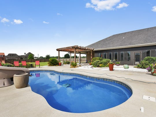 The fabulous pool is surrounded by outdoor living and