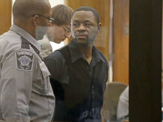 Antonio Smith looks to the gallery as he leaves a Milwaukee County courtroom during his trial.