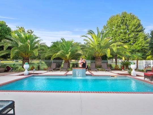 The luxurious home also has extra acreage for sale.