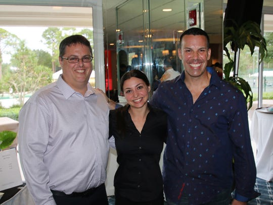 Ed Alonzo, left, Kayla DeGeorges, and Rob Fonteyn, members of LifeBuilders of the Treasure Coast, enjoy the group's annual party.
